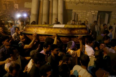 People attend the funeral ceremony held for eight victims of the Saint Samuel's Monastery attack in Egypt's southern Minya province, Cairo, Egypt on May 26, 2017 [Ahmed Al Sayed / Anadolu Agency]