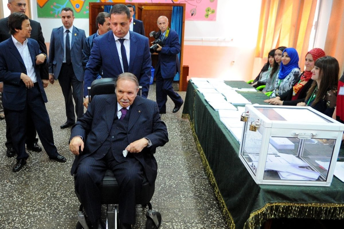 President of Algeria Abdelaziz Bouteflika casts his ballot to elect members of the country's 462-seat parliament in Algiers on May 4, 2017 [Bechir Ramzy/Anadolu Agency]