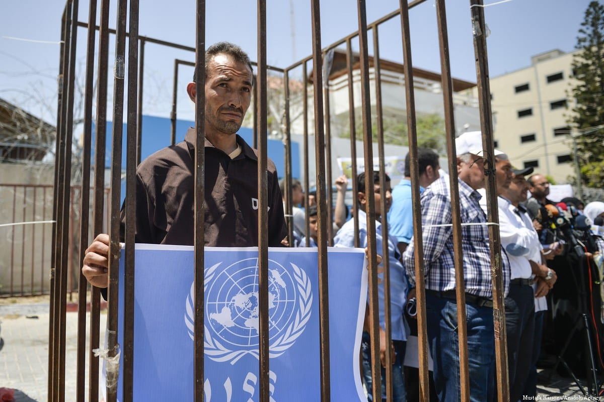Palestinians gather in front of the UNESCO office during a demonstration in solidarity with Palestinian prisoners in Israel jails in Gaza City, Gaza on 9 May 2017 [Mustafa Hassona/Anadolu Agency]