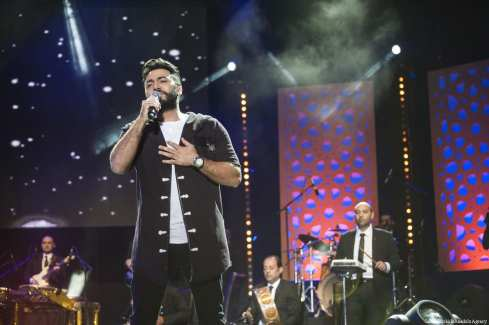 Tunisian singer Lotfi Bouchnak, US singer Nick Jonas and Egyptian singer Tamer Hosny performs during the 16th International Mawazine Music Festival in Morocco, Rabat on 18 May, 2017 [Jalal Morchidi/Anadolu Agency]