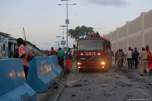 Firefighters arrive at the scene of a car bomb explosion which killed at least five people in Mogadishu, Somalia on May 24, 2017 [Sadak Mohamed/Anadolu Agency]