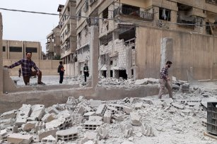 Syrians inspect the debris after the Assad Regime carried out airstrike in Eastern Ghouta, Syria on 1 May 2017 [Samir Tatin/Anadolu Agency]