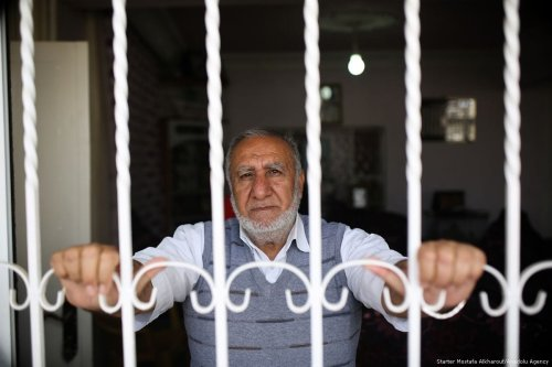 69-year-old Palestinian Mahmud Deacine, who spent 21 years of his life in Israeli prisons, poses for a photo during an interview in Jerusalem on April 17, 2017 [Mostafa Alkharouf/Anadolu Agency]