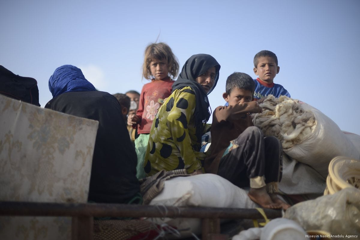 Civilian, who fled Raqqa, arrive in Jarabulus, Syria on May 26, 2017. Civilians living around Raqqa flee to opposition controlled safe zones due to clashes between Daesh and PYD/ PKK terrorist organisations. [Hüseyin Nasır/Anadolu Agency]