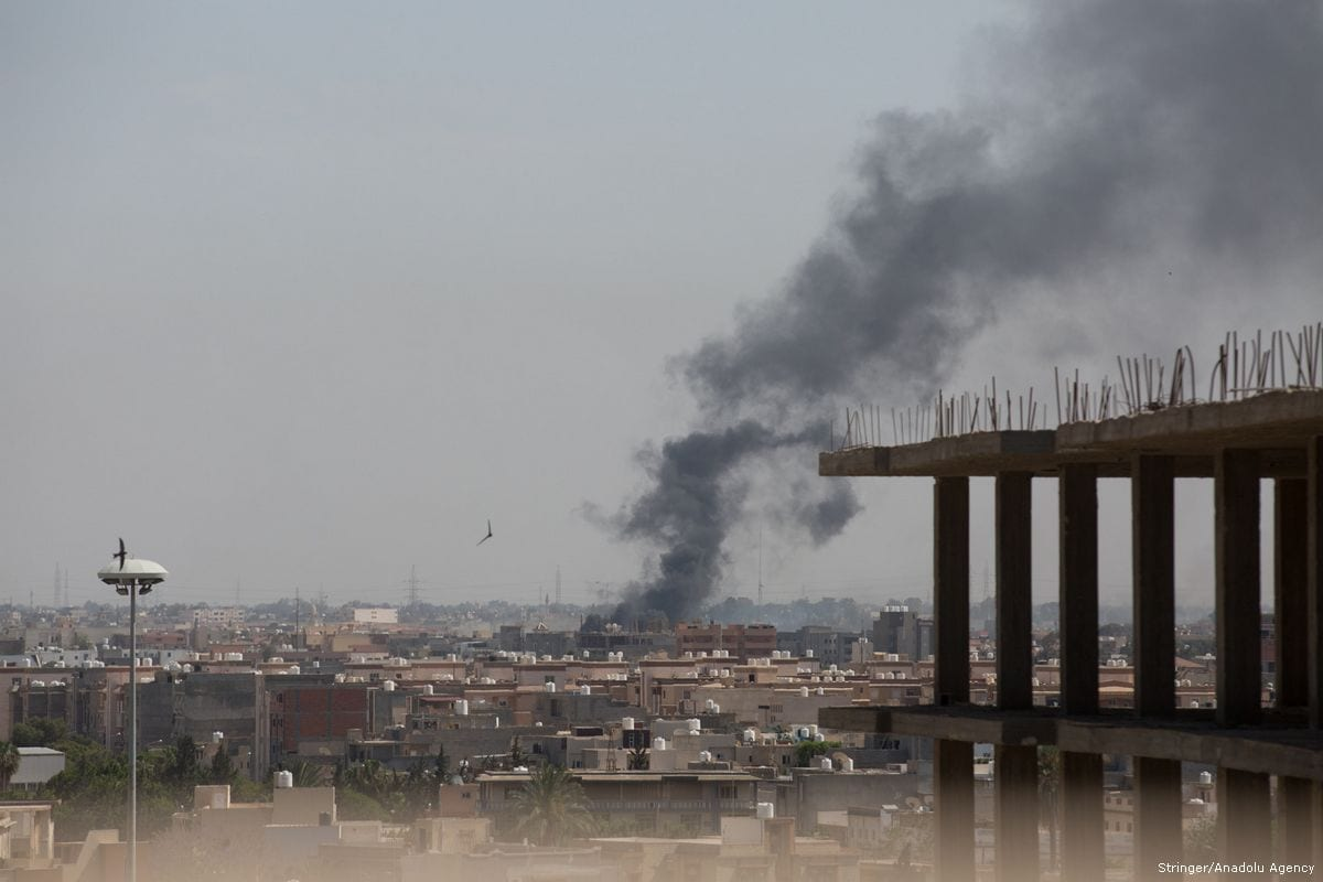 Smoke rises after clashes between National Reconciliation Government of Libya and National Liberation Government in Tripoli, Libya on May 26, 2017 [Stringer/Anadolu Agency]