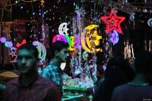 GAZA- Palestinians attend a market in preparation of the holy month of Ramadan