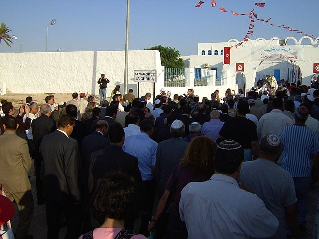 The Lag BaOmer procession returning to the Ghriba Synagogue in Er-Riadh, Djerba, Tunisia.[Chesdovi/Wikimedia]