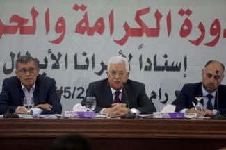 Palestinian President Mahmoud Abbas (C) speaks during a Revolutionary Council Meeting of Fatah Movement with the attendance of Secretary of the Revolutionary Council of the Fatah movement, Majed Al Fityani (L) in Ramallah, West Bank on May 25, 2017 [Issam Rimawi/Anadolu Agency]