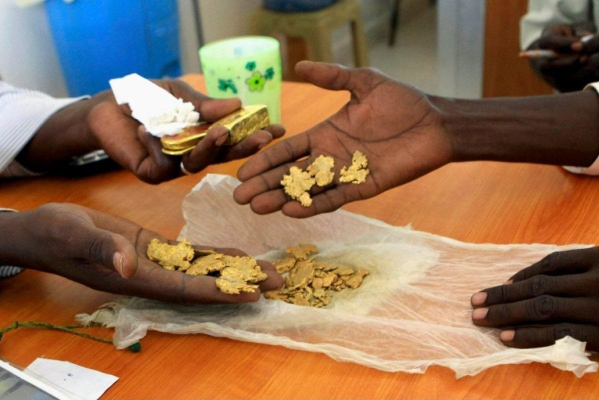 A gold mine worker get his raw gold weighed at a shop in Al-Fahir, Sudan, in 2013 [Reuters]