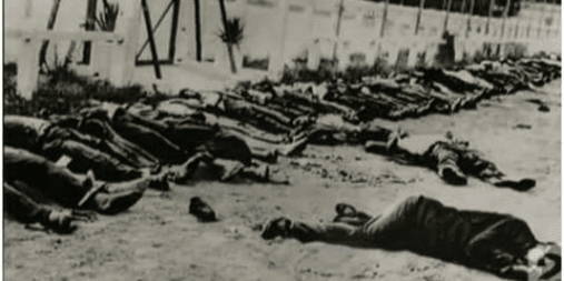 Image of French soldiers standing in front of Algerians, massacred in 1945 [5pillarsUK]
