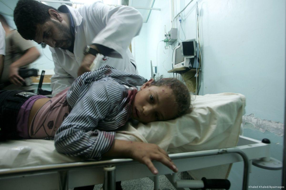 Image of an injured Palestinian receiving medical care at the Al-Najar hospital in Gaza on 20 October 2013 [Khaled Khaled/Apaimages]