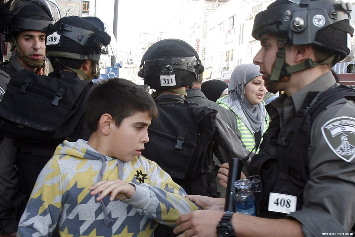 Image of Israeli forces arresting a Palestinian child on 22 November 2012 [Mahfouz Abu Turk/Apaimages]