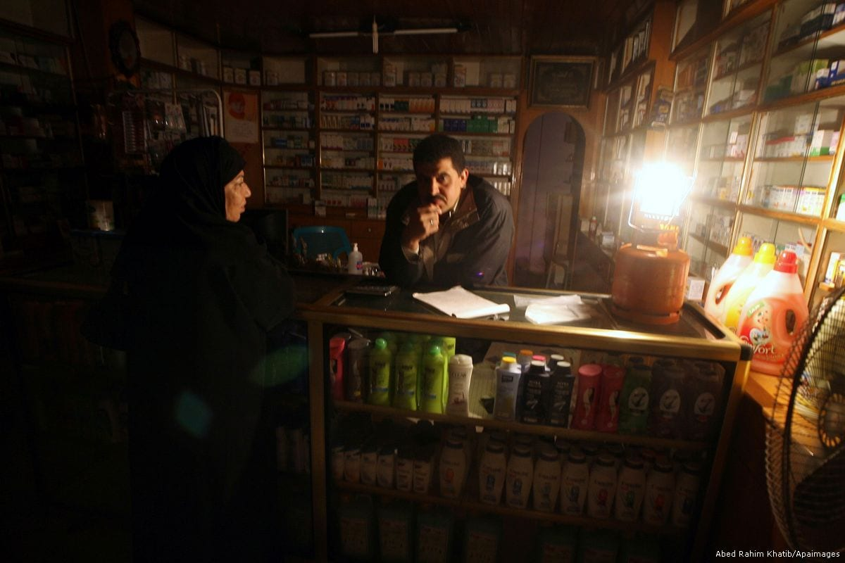 https://i0.wp.com/www.middleeastmonitor.com/wp-content/uploads/2017/06/2012_1_27-Palestinian-man-working-in-a-pharmacy-and-lit-a-gas-lantern-during-a-power-cutAB00-4.jpg