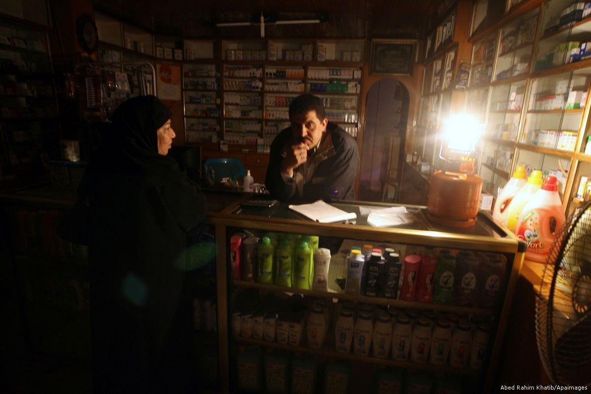 A Palestinian man has lit a gas lantern during a power shortage in Rafah, Gaza on 27 January 2012 [Abed Rahim Khatib/Apaimages]