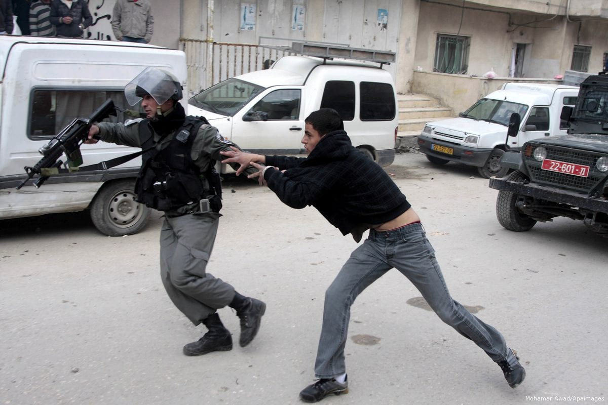 Image of Israeli forces arresting a Palestinian youth on 8 February 2012 [Mohamar Awad/Apaimages]