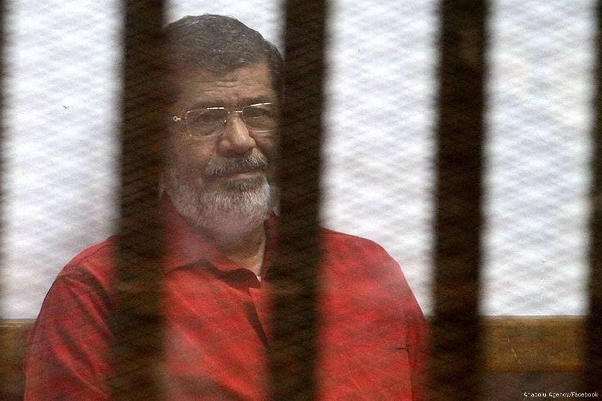 Egypt's ousted president Mohamed Morsi, wearing an orange uniform while in prison on 18th August 2016 [Anadolu Agency/Facebook]