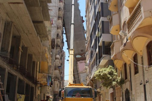 Construction work takes place after a 12-storey apartment building collapsed in Alexandria, Egypt on June 1, 2017 [Ahmed Abd Alkawey/Anadolu Agency]