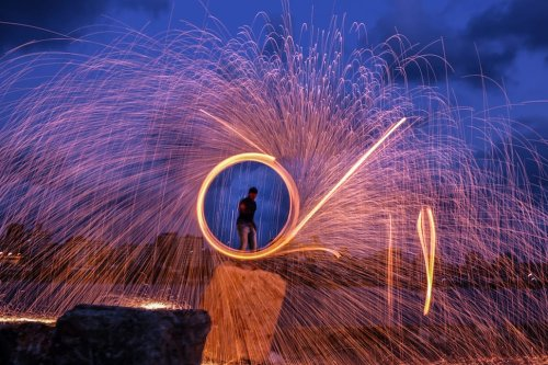 A man performs Poi fire spinning during the holy month Ramadan in Gaza City, Gaza on June 1, 2017 [Ali Jadallah/Anadolu Agency]