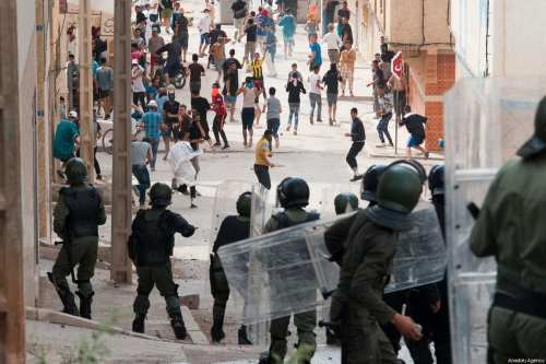 Protesters clash with security forces during a demonstration in Morocco [Jalal Morchidi/Anadolu Agency]