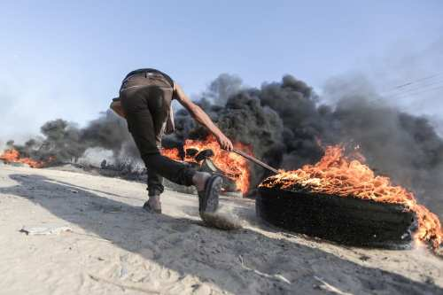 Palestinians burn tires during the protest against Israeli siege over Palestinian lands at the Gaza border, Gaza on 5 June, 2017 [Mustafa Hassona/Anadolu Agency]