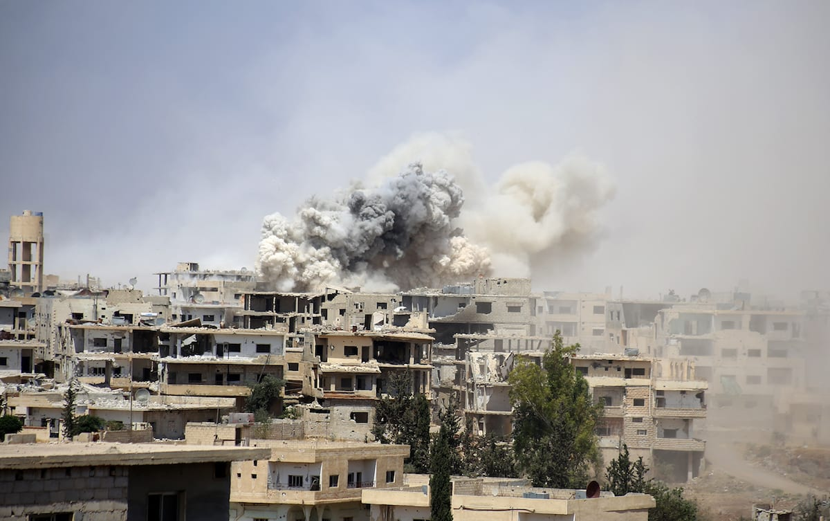 Smoke rises after the Assad regime carried out airstrikes over residential areas in Daraa, Syria on 14 June 2017 [Muhammed Yusuf/Anadolu Agency