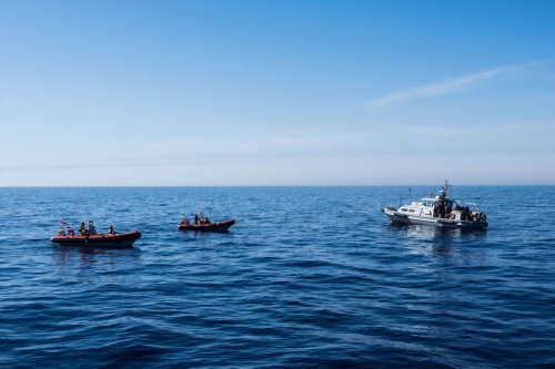 Libyan Coast Guards are seen in the Mediterranean Sea reusing migrants, near Libya [Marcus Drinkwater / Anadolu Agency]