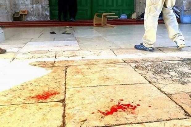 Blood is seen on the ground after Israeli forces fired tear gas at worshippers in Al-Aqsa Mosque on 19 June 2017 [Abbs Winston/Twitter]