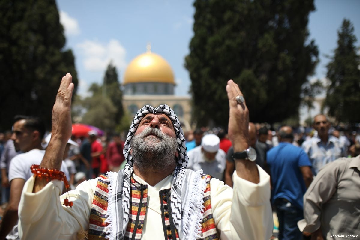 Muslims perform the first Friday Prayer during the holy month of Ramadan at Al-Aqsa Mosque courtyard in Jerusalem on June 02, 2017 [Mostafa Alkharouf/Anadolu Agency]