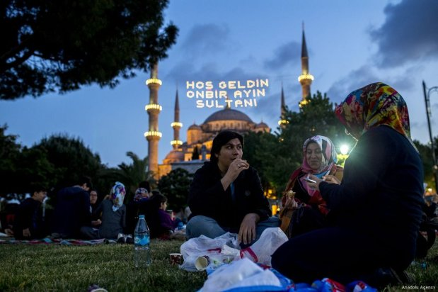 Turks communally break their fast in the gardens of the famous Blue Mosque