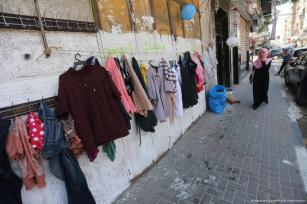 A 'Wall of Blessings' has been set up in the Gaza Strip to help those in need get new items of clothing and toys ahead of the Muslim celebration of Eid on 23 June 2017 [Mohammed Asad/Middle East Monitor]