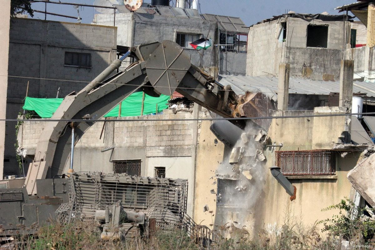 Image of an Israeli military bulldozer demolishing a Palestinian home in Qalqilya, West Bank [Apaimages]