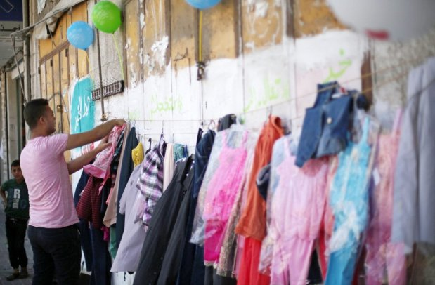 GAZA- The only wall Palestinians need is a wall of blessings! A charity wall is set up for Gazans to donate and to take clothes