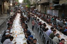 DAMASCUS, SYRIA- A mass Ramadan dinner is organised in Douma around the wreckage of buildings in the Arbin district which has been under blockade for last four years by the Assad regime