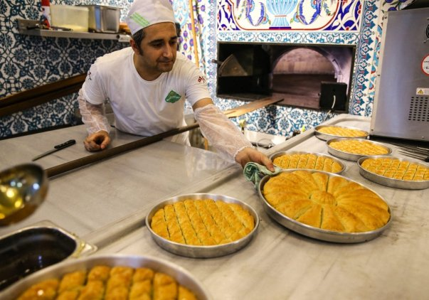 ISTANBUL, TURKEY- WARNING this image will cause severe drooling and hunger! Trays of Baklawa are prepared for Eid that marks the end of Ramadan