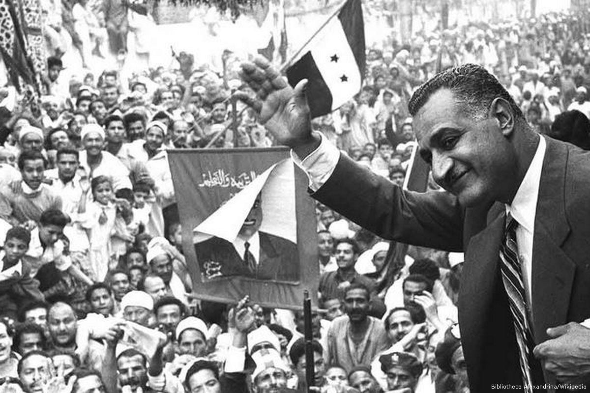 Former Egyptian President Gamal Abdel Nasser waves to crowds in Mansoura  from a train car on