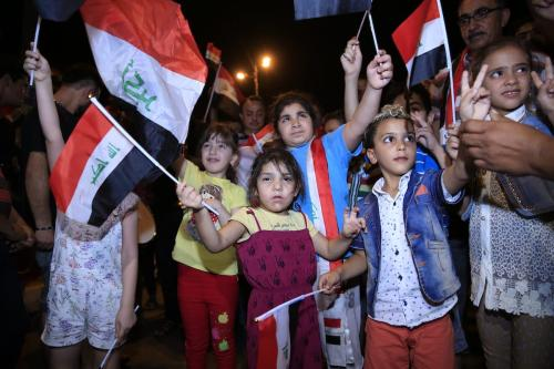 People celebrate after Mosul was freed from Daesh at al-Tahrir square in Baghdad, Iraq on July 9, 2017 [Murtadha Sudani / Anadolu Agency]