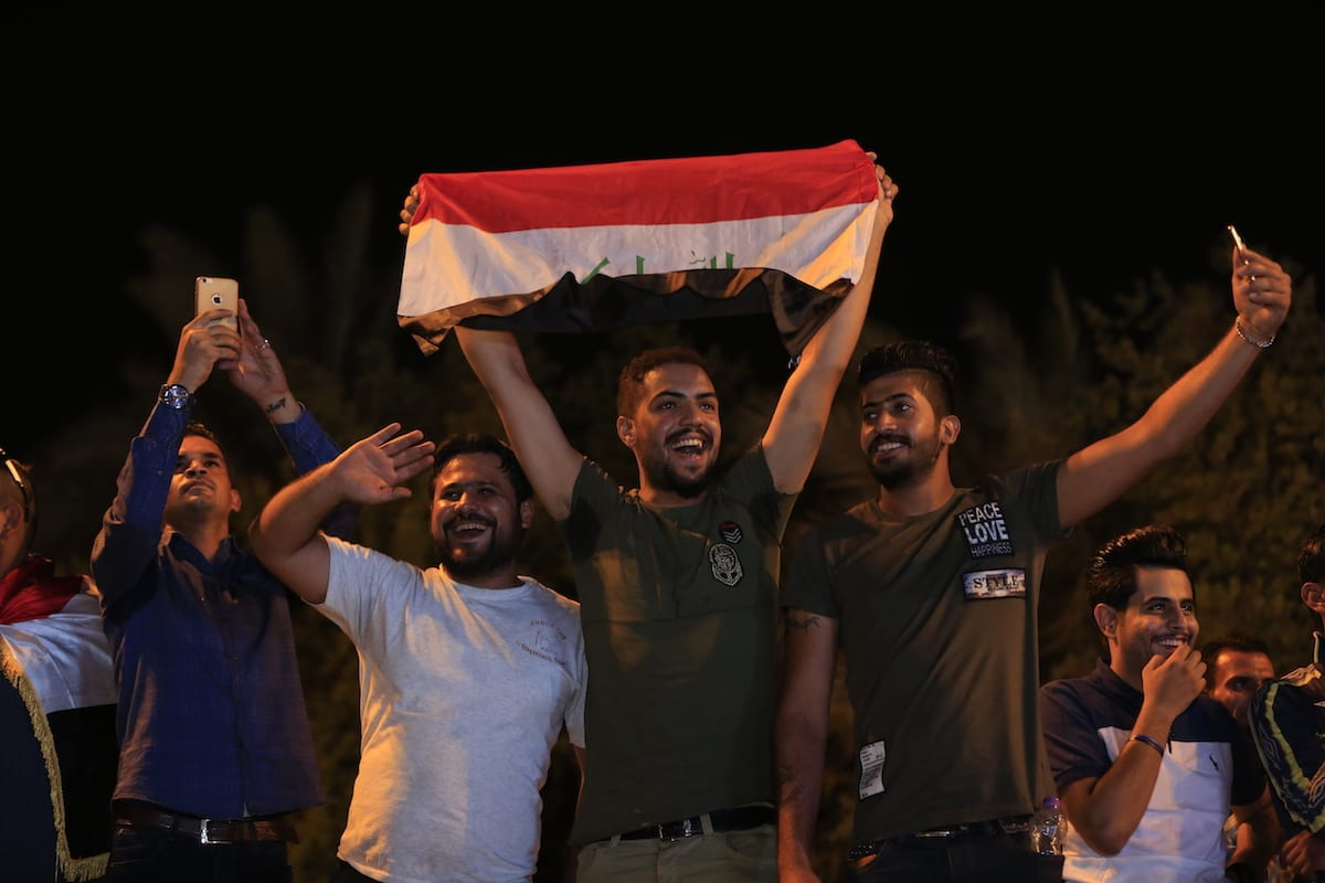 People attend a concert to celebrate Mosul being completely freed from Daesh at al-Tahrir square in Baghdad, Iraq on 11 July, 2017 [Murtadha Sudani/Anadolu Agency]