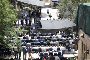 Palestinian worshippers perform prayers outside one of the main entrances to the Al-Aqsa mosque, refusing to enter because of new metal detectors installed at entrances as the holy site re-opened for the first time on Sunday since a two-day closure following a deadly shootout in Jerusalem on July 16, 2017 [Mostafa Alkharouf / Anadolu Agency]