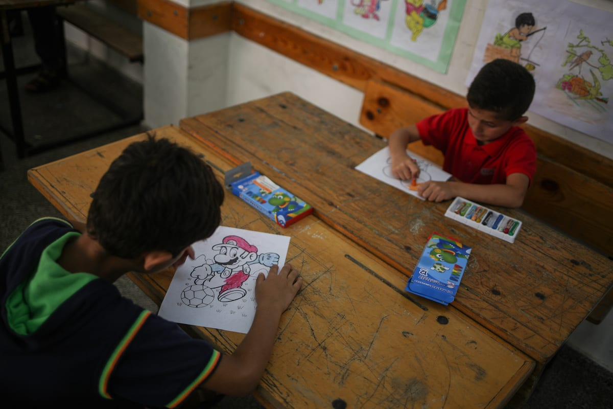 Palestinian students attend activities during a summer camp, organized by the United Nations Relief and Works Agency for Palestine Refugees (UNRWA) at Zaitoun School in Gaza City, Gaza on 18 July, 2017 [Ali Jadallah/Anadolu Agency]