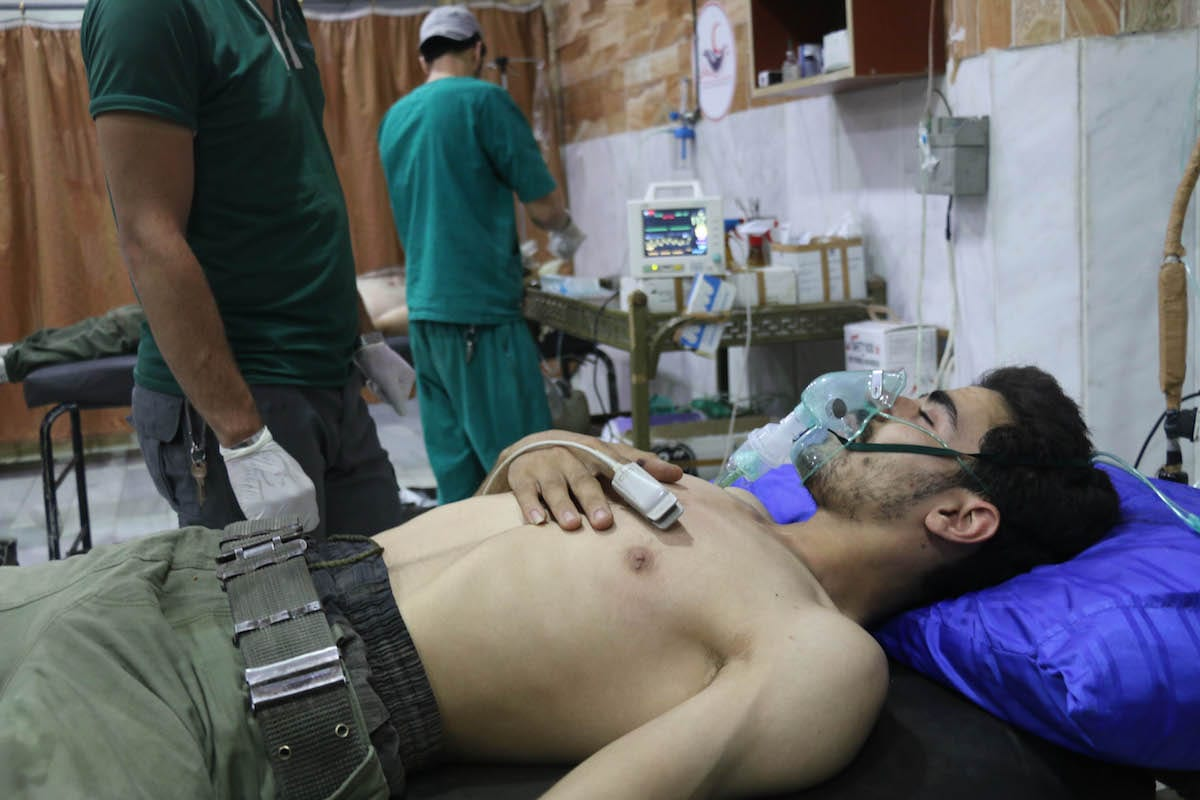 Opposition forces receive medical treatment after the Assad regime allegedly carried out a chemical gas attack in the de-conflict zone in Damascus, Syria on 20 July 2017 [Alaa Muhammed/Anadolu Agency)