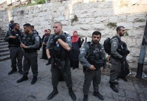 Israeli security forces perform identity checks and searches on Palestinians outside the Al Aqsa Mosque on 20 July 2017 [Mostafa Alkharouf/Anadolu Agency]