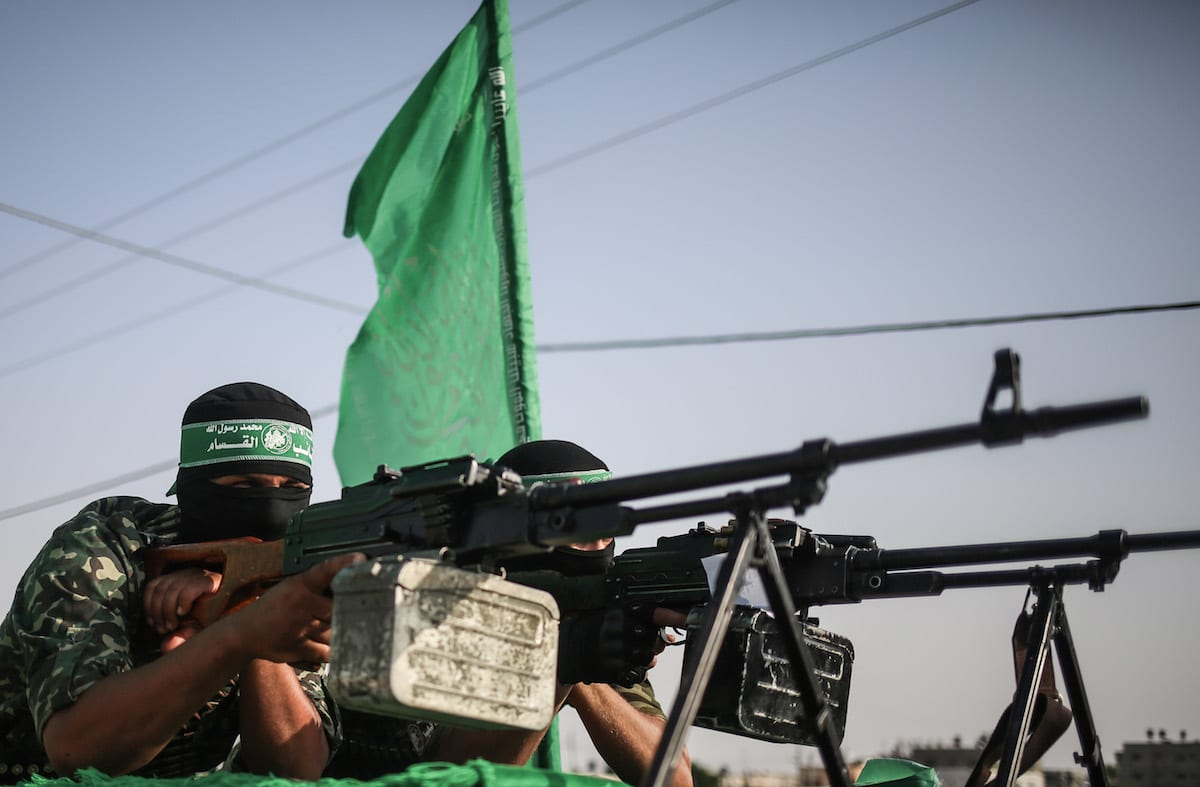 Members of Izz ad-Din al-Qassam Brigades, the armed wing of the Hamas, take part in a military parade on the third anniversary of Israel's attacks on Gaza in Khan Yunis, Gaza on 20 July 2017 [Mustafa Hassona/Anadolu Agency]