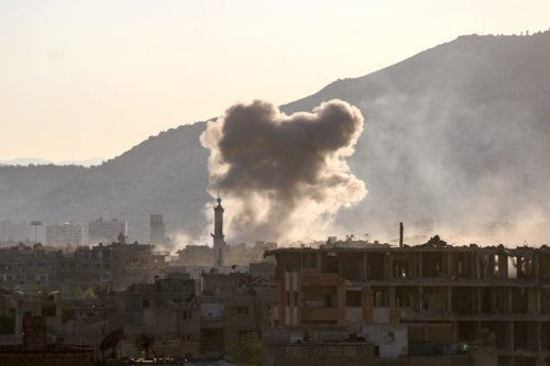 Smoke rises after aircraft belonging to Assad regime forces carried out airstrikes over the de-conflict zone, Arbin town of Eastern Ghouta region in Damascus, Syria on 25 July, 2017 [Ammar Al Bushy/Anadolu Agency]