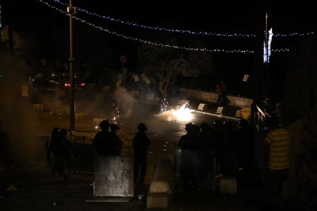 Israeli security forces intervene in Palestinians with plastic bullets, stun grenades and tears gas after Palestinians performed evening prayer in front of Al-Aqsa Mosque Compound's Lion Gate in Jerusalem on 25 July, 2017 [Mostafa Alkharouf/Anadolu Agency]