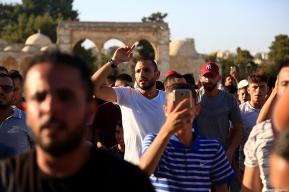JERUSALEM - JULY 28 : Palestinians gather to celebrate near Jerusalem's Old City as they enter the Al Aqsa Mosque following the removal of Israeli security measures at the entrances to Al Aqsa Mosque in Jerusalem on July 28, 2017. ( Enes Canlı - Anadolu Agency )