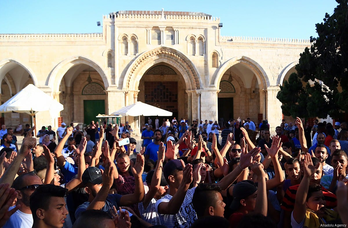 Palestinians gather to celebrate outside the Al-Aqsa Mosque following the removal of Israeli security measures at the entrances to Al-Aqsa Mosque in Jerusalem on 28 July 2017 [Enes Canlı/Anadolu Agency]