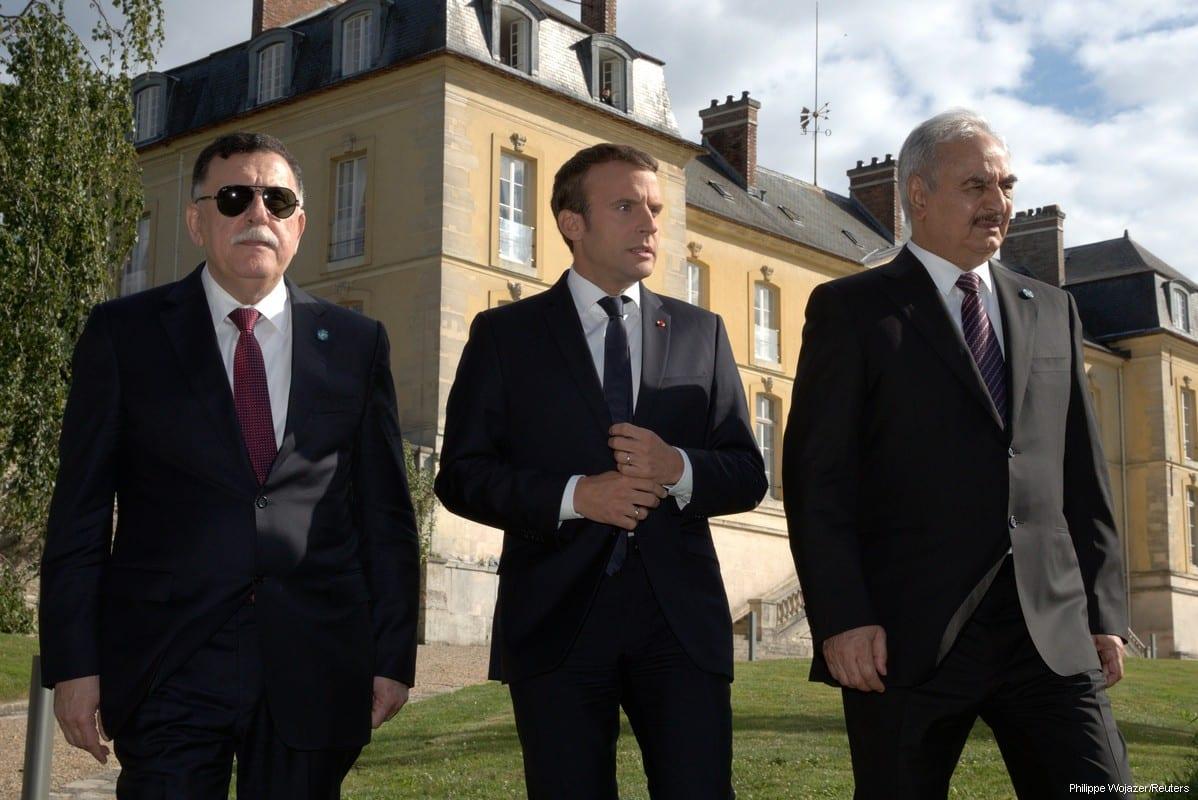Head of the Libyan Presidency Council, Fayez Al-Sarraj, and Field Marshal Khalifa Haftar, head of the Libyan National Army met with French president Emmanuel Macron in Paris on 25 July, 2017 [Philippe Wojazer/Reuters]