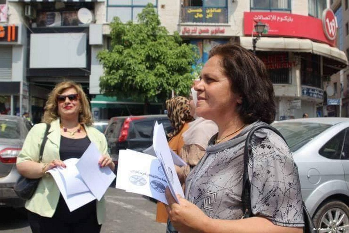 Image of Khitam Al-Saafin (L) head of the Union of Palestinian Women's Committees [ISM Palestine/Twitter]