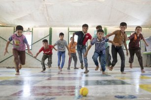Syrian children play ball games at Za'atari refugee camp in Jordan which is home to 80,000 Syrian refugees [Save the Children]