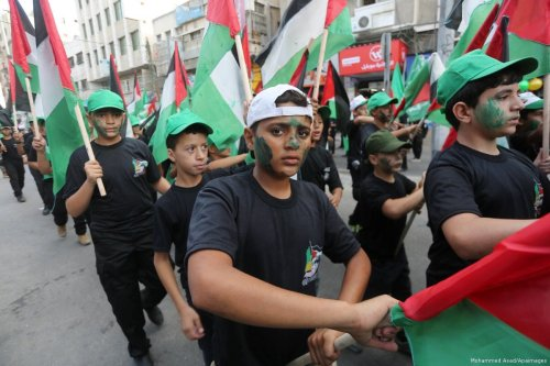 Palestinian youths take part during a rally, protesting against Israel's violations on Al-Aqsa Mosque in Gaza City on 27 July 2017 [Mohammed Asad/Middle East Monitor]